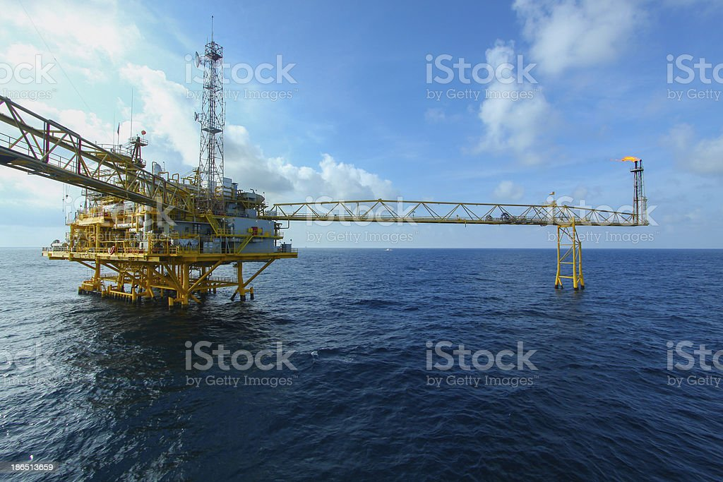 Oil and gas platform in sunset or sunrise time stock photo