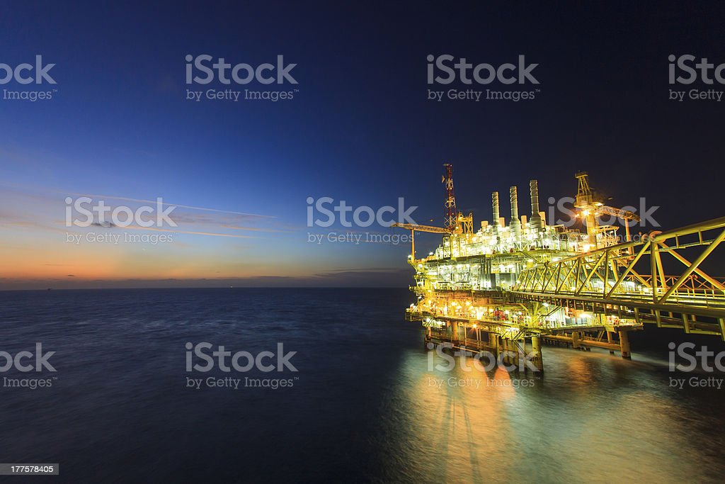 Oil and gas platform on sunrise time stock photo
