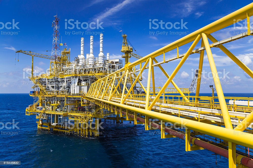 Oil and Gas production platform in blue sky stock photo