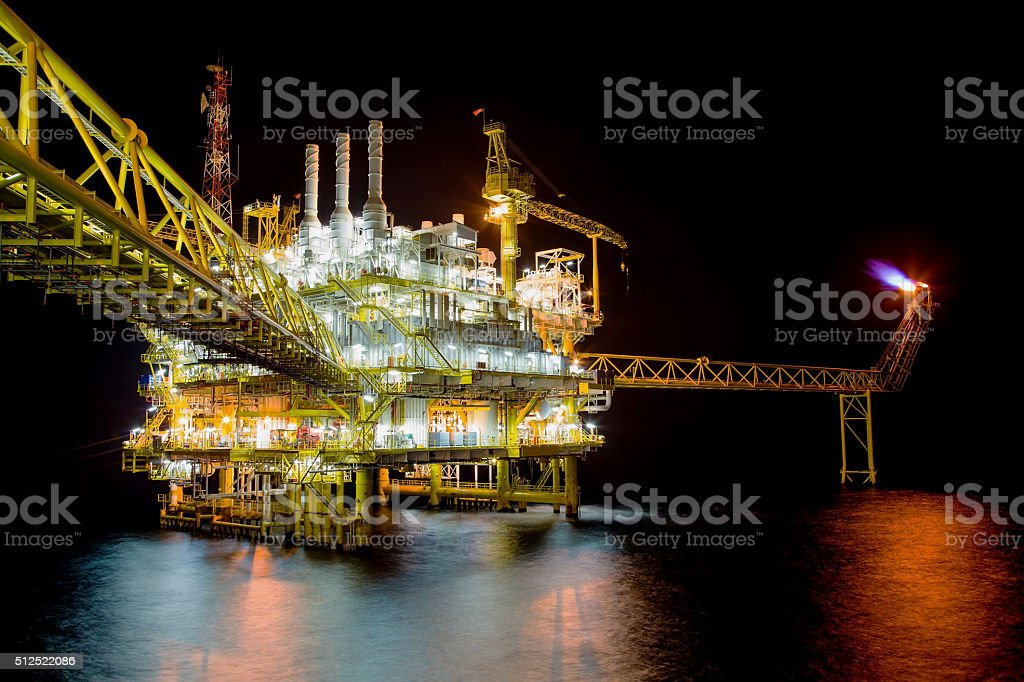 Oil and Gas production platform in night scene stock photo