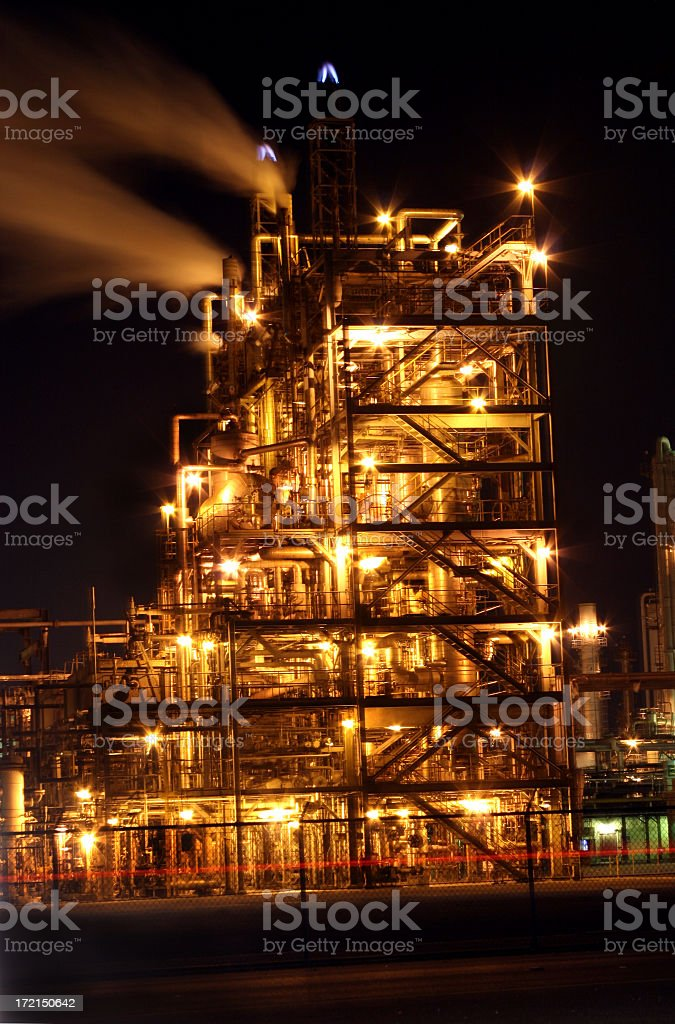 Oil and gas refinery at night. Lights. Smoke. royalty-free stock photo
