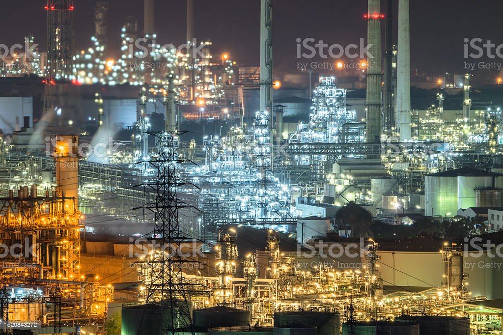 Oil and gas refinery plant area at night stock photo
