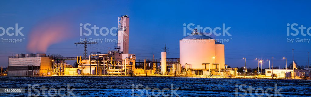 Oil and Gas Storage Tanks Illuminated at Night stock photo
