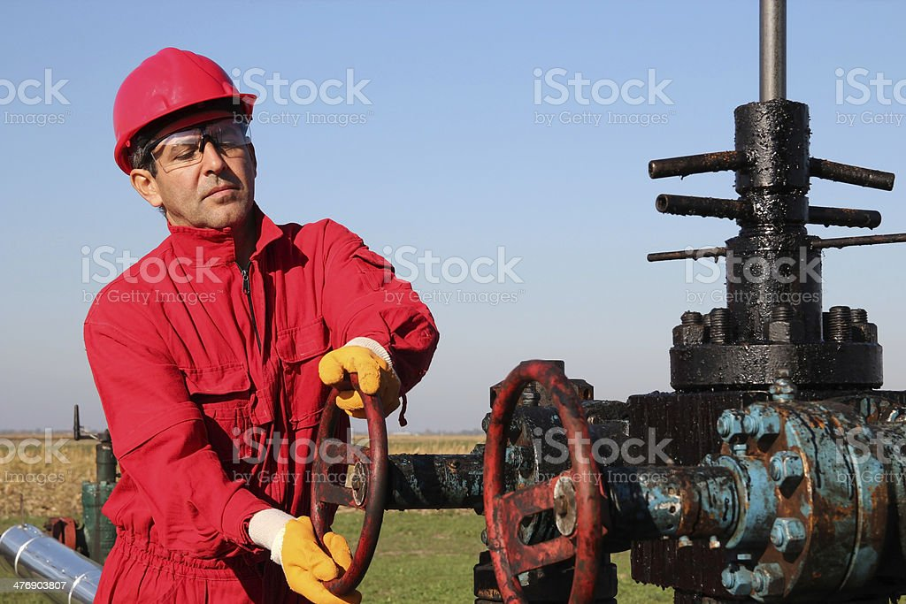Oil and Gas Well Drilling Worker royalty-free stock photo