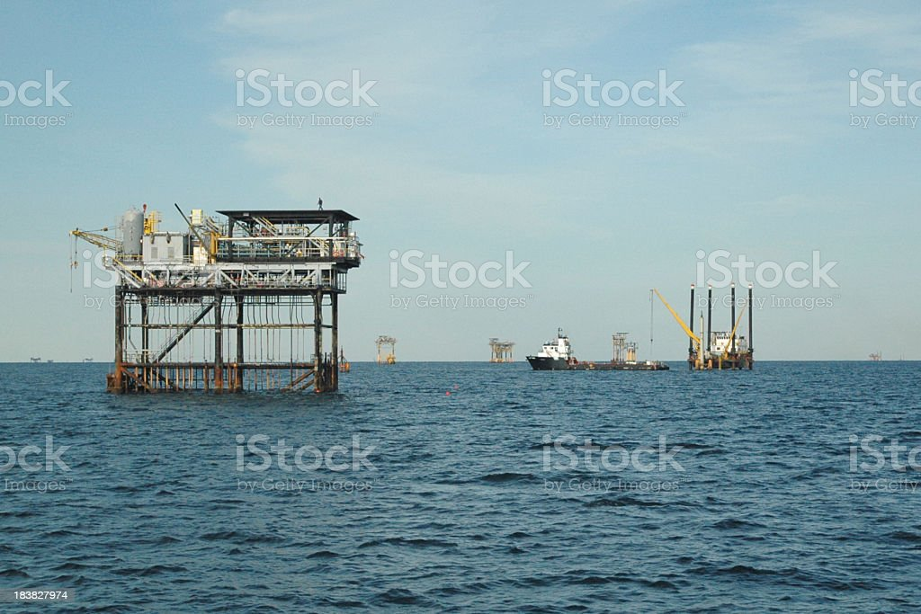 oil and gas well field stock photo