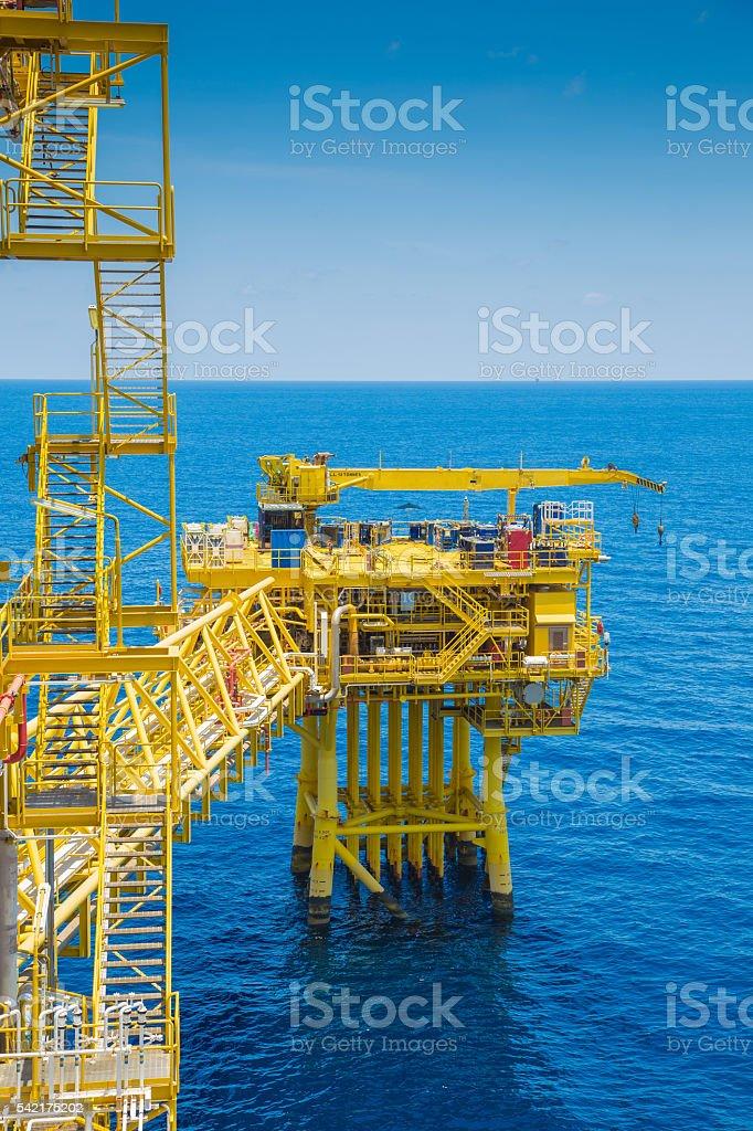 Oil and gas wellhead remote platform nearly close processing platform stock photo