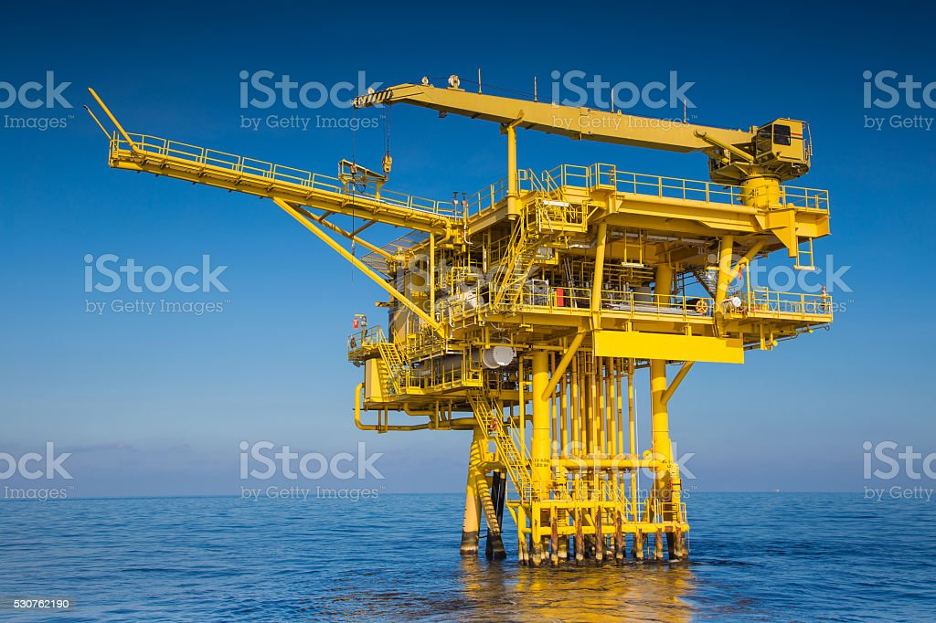 Oil and gas wellhead remote platform stock photo