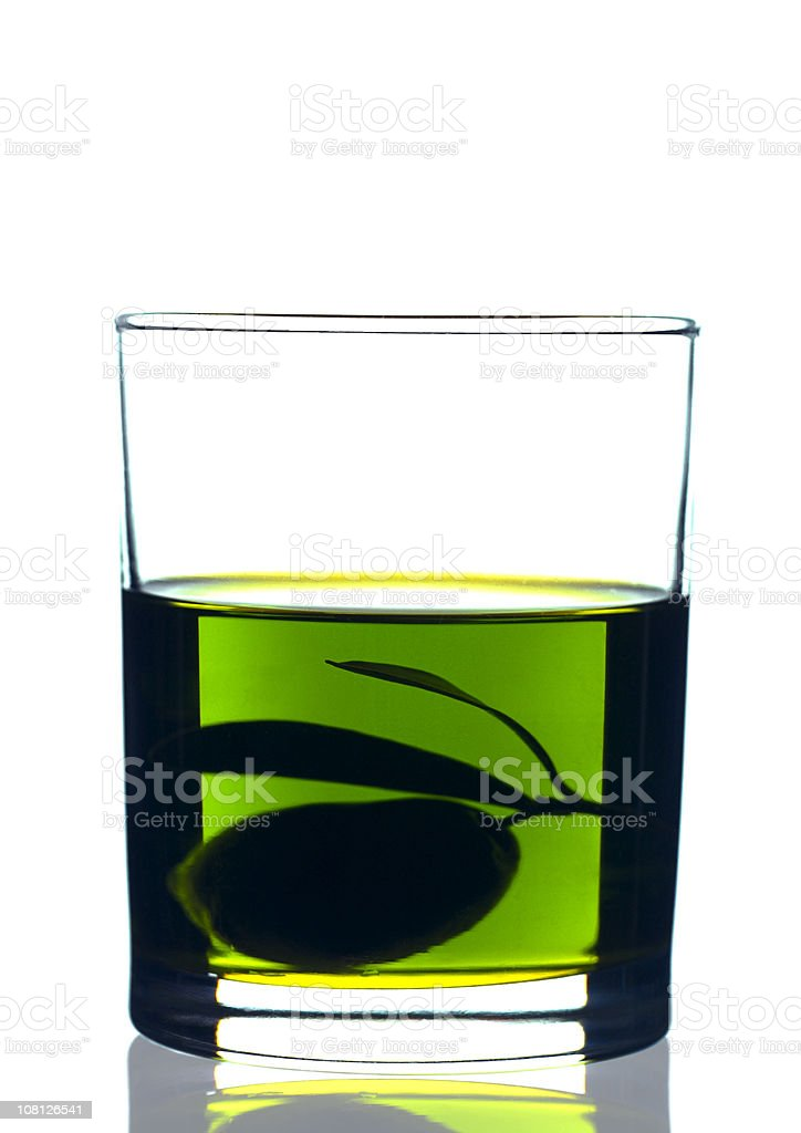 Oil and Olive Fruit Sitting in Glass royalty-free stock photo