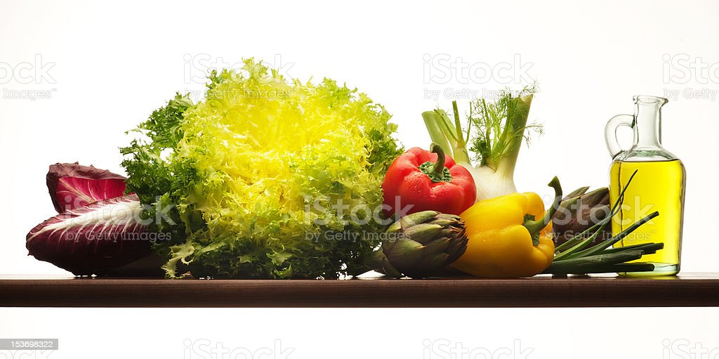 Oil and vegetables  isolated on white background royalty-free stock photo