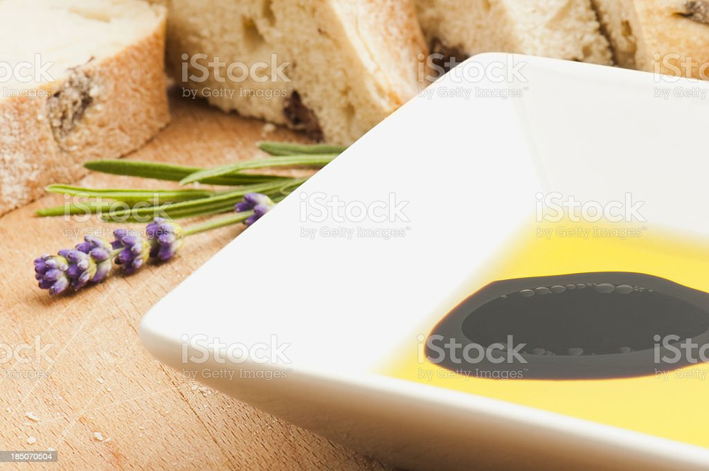 Oil and vinegar with fresh bread and lavender royalty-free stock photo