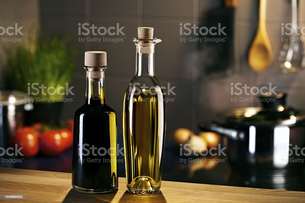 Oil and vingar bottles in front of a kitchen royalty-free stock photo