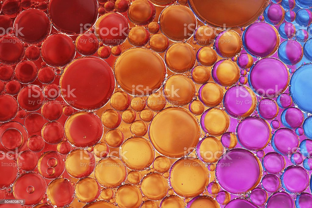 Oil and water over colors 18 stock photo