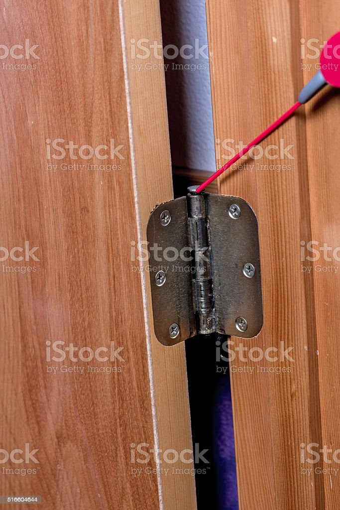 Oil being applied to a hinge stock photo