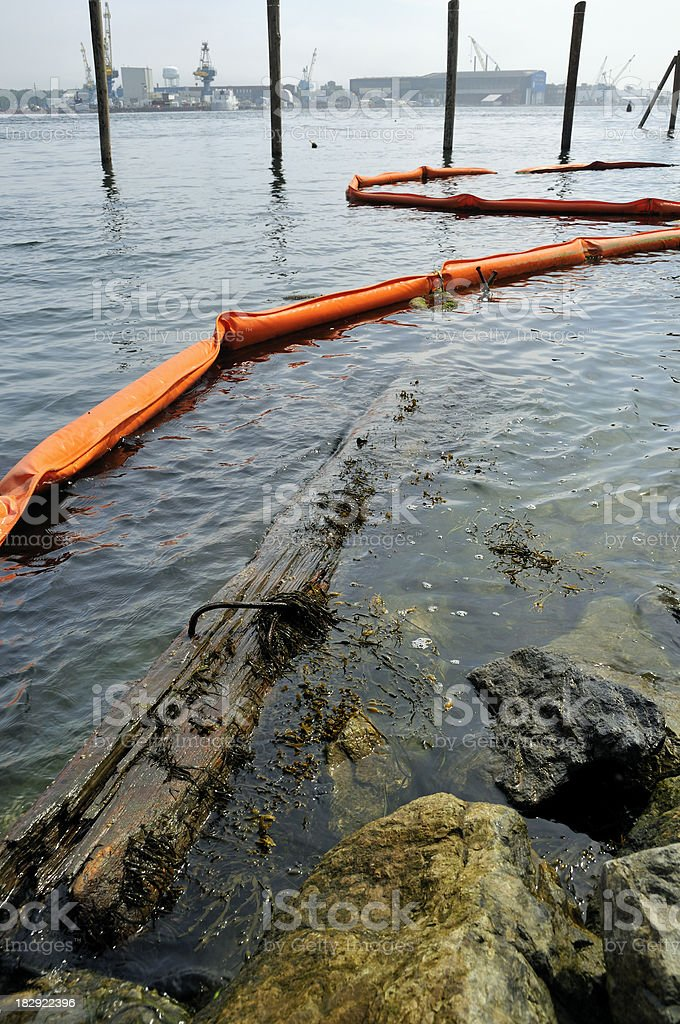 Oil Boom in Water with Flotsam and Jetsam royalty-free stock photo