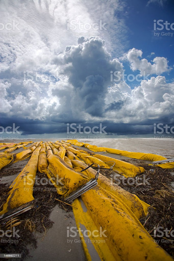 Oil boom on the beach royalty-free stock photo
