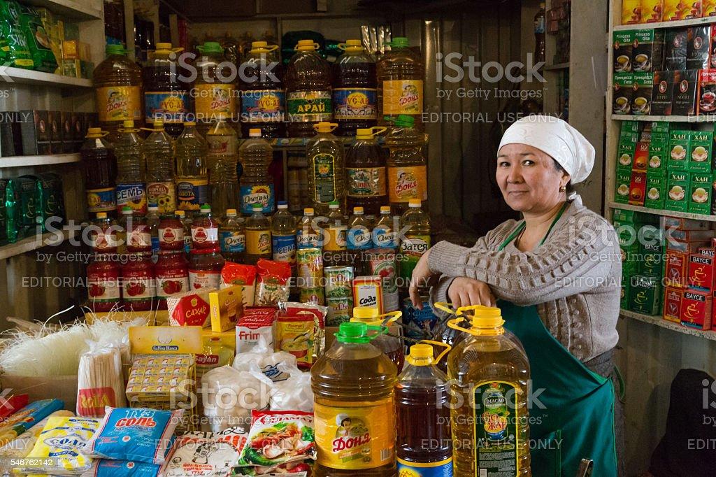 Oil bottles vendor at the bazar in Osh, Kyrgyzstan stock photo