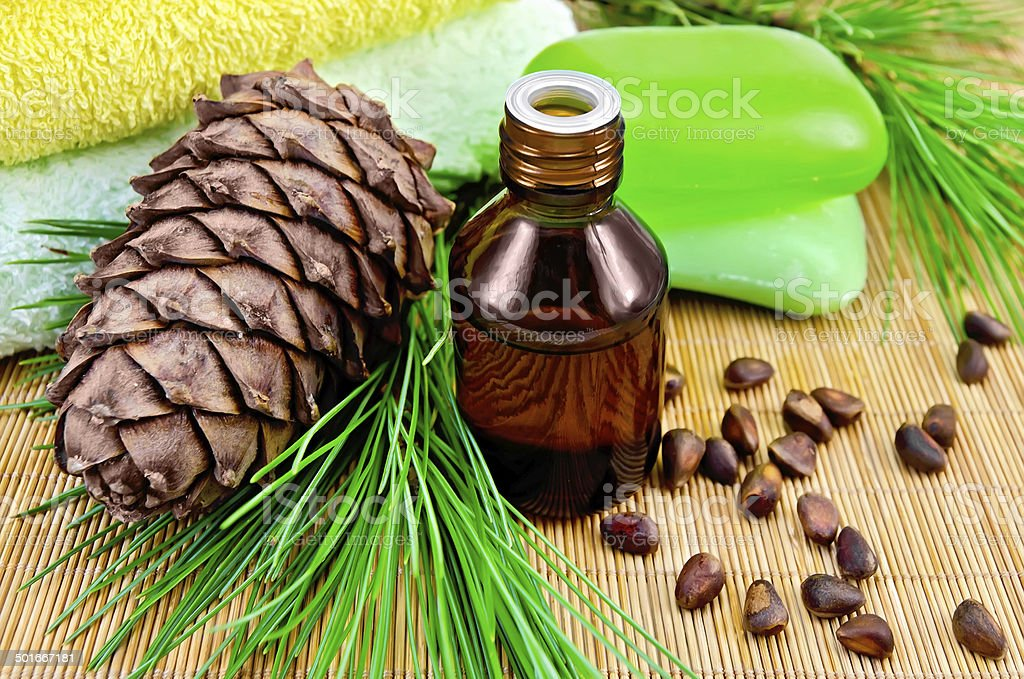 Oil cedar with pine cones and soap stock photo