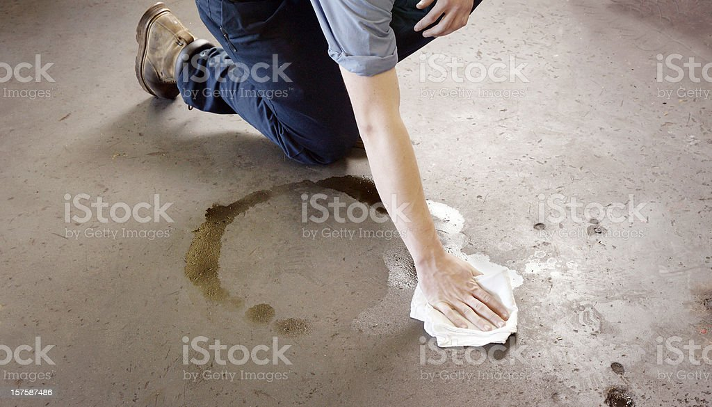 Oil clean-up in a garage or workshop stock photo