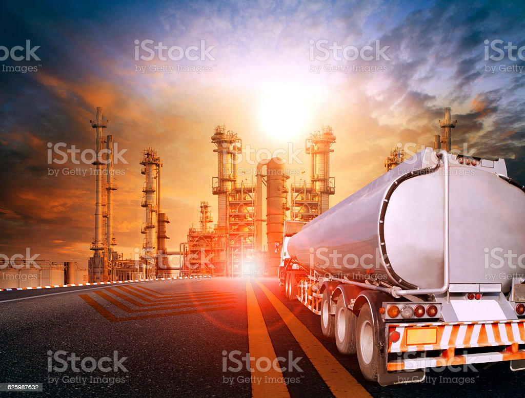 oil container truck and heavy petrochemical industries plant for stock photo