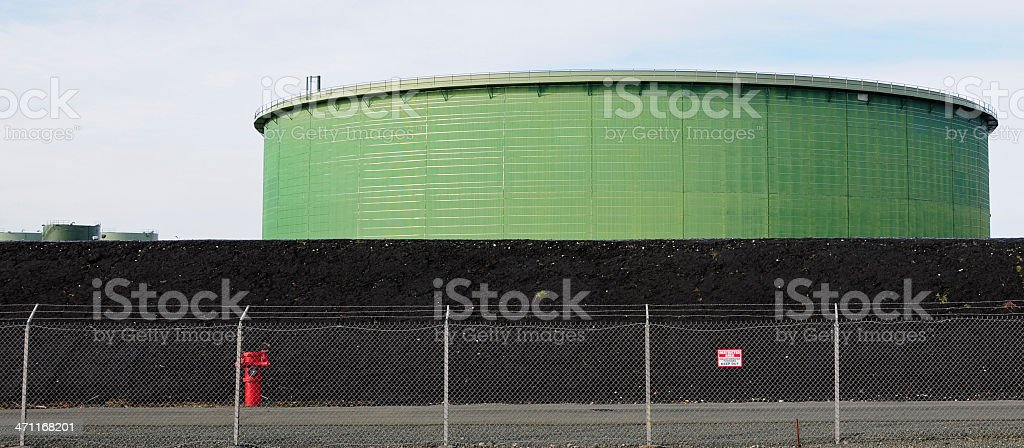 Oil containers at refinery royalty-free stock photo