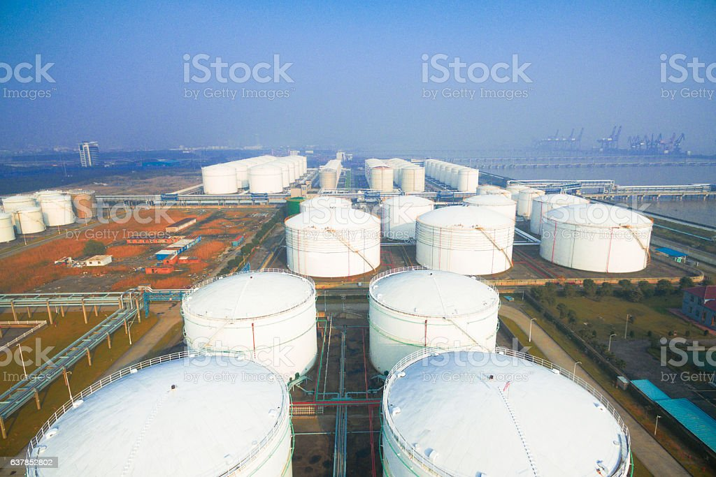 oil containers in modern refinery plant in blue sky stock photo