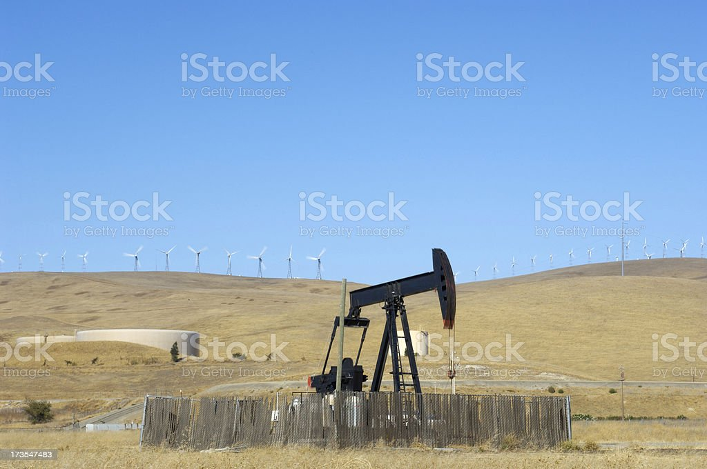 Oil Derrick and Wind Turbines royalty-free stock photo