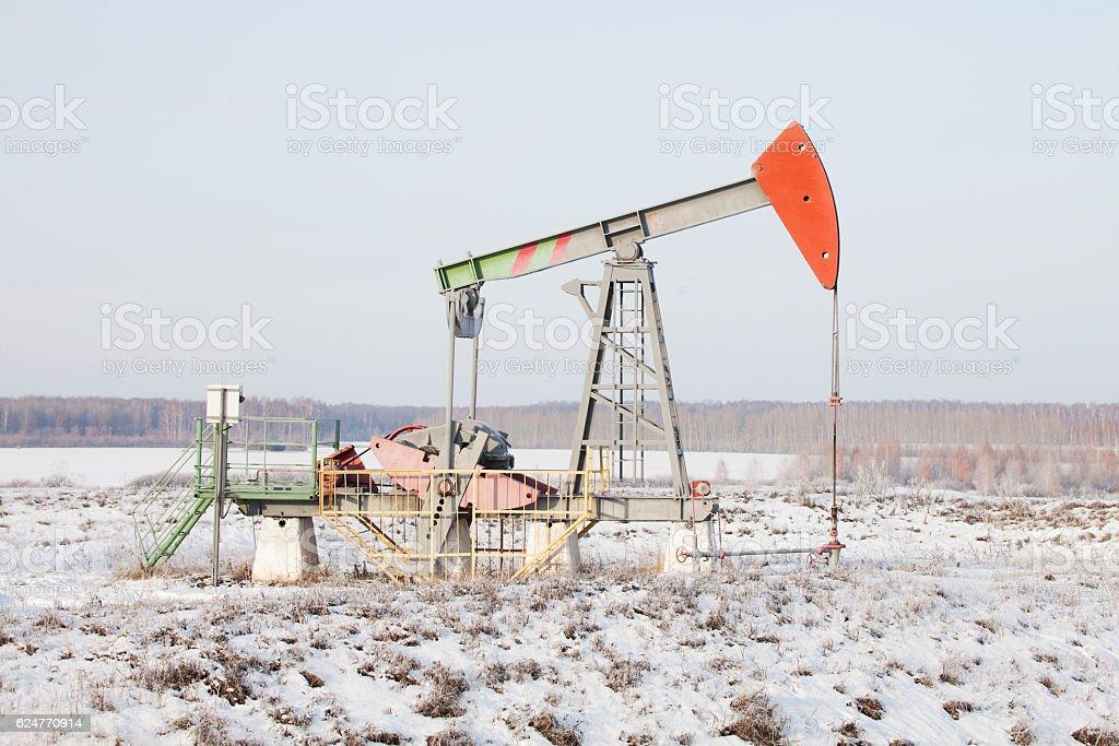 Oil derrick (pump jack). Bashkortostan, Russia. Winter stock photo