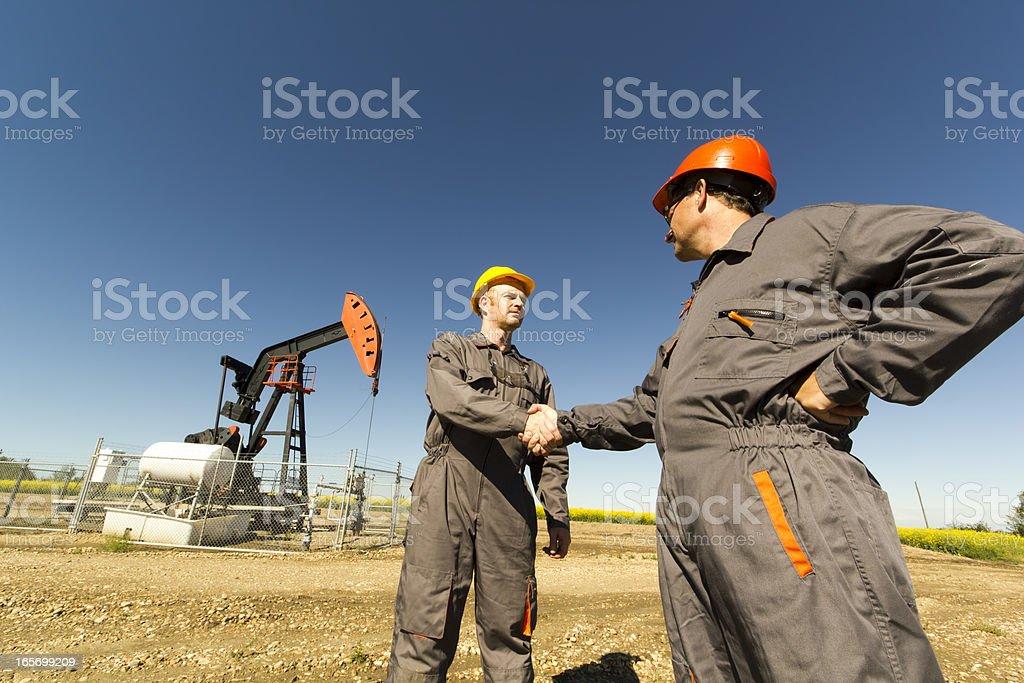 Oil Derrick Handshake stock photo