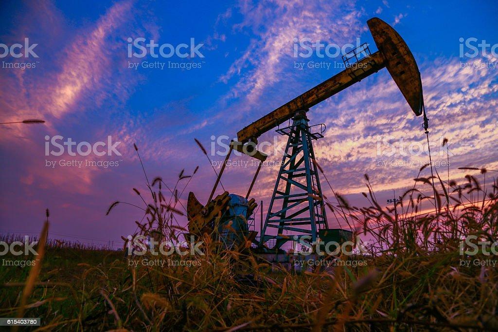 oil derrick in night stock photo