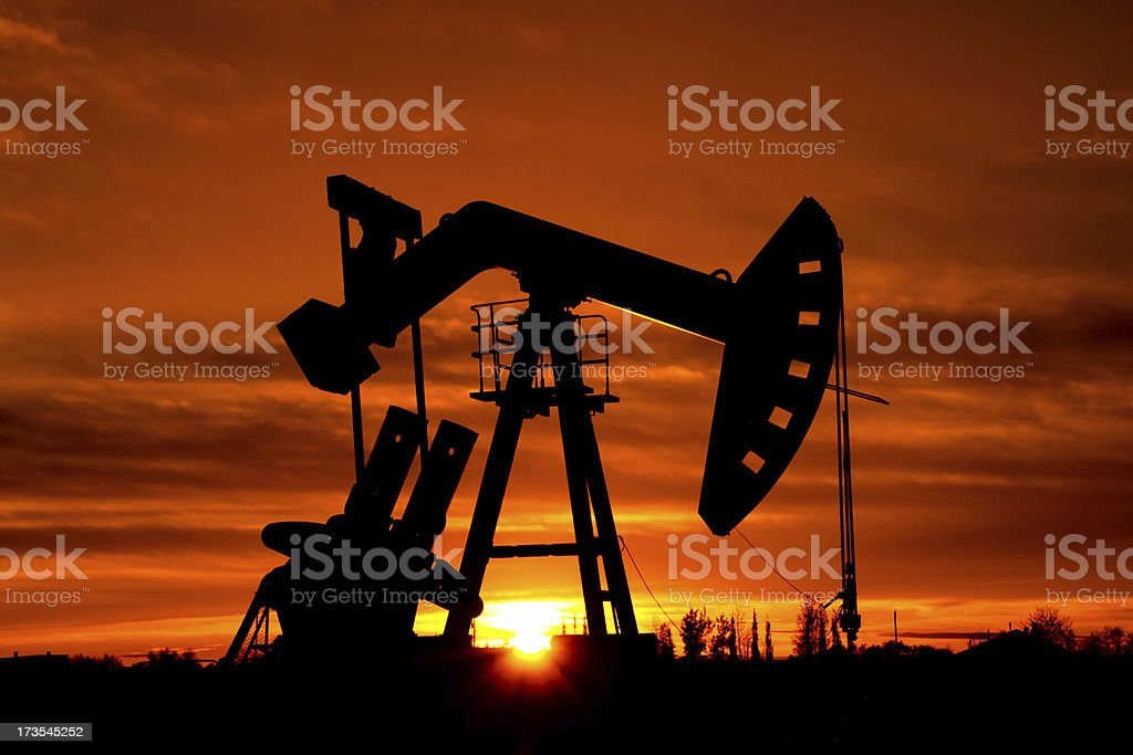 Oil Derrick with a red sky royalty-free stock photo