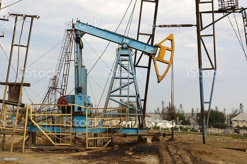 Oil derricks on the shore royalty-free stock photo
