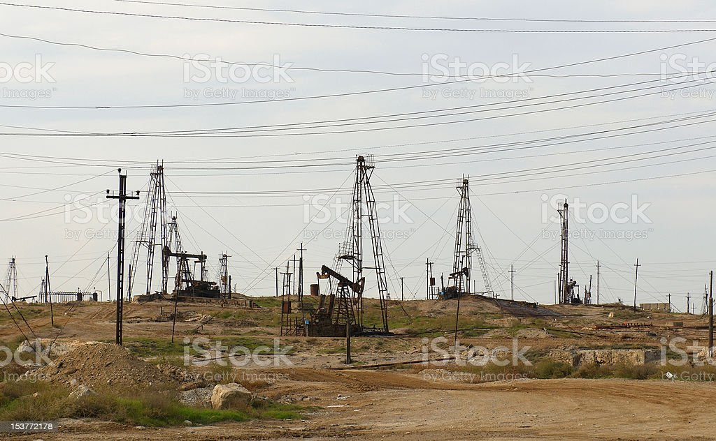 Oil derricks on the shore royalty-free stock photo