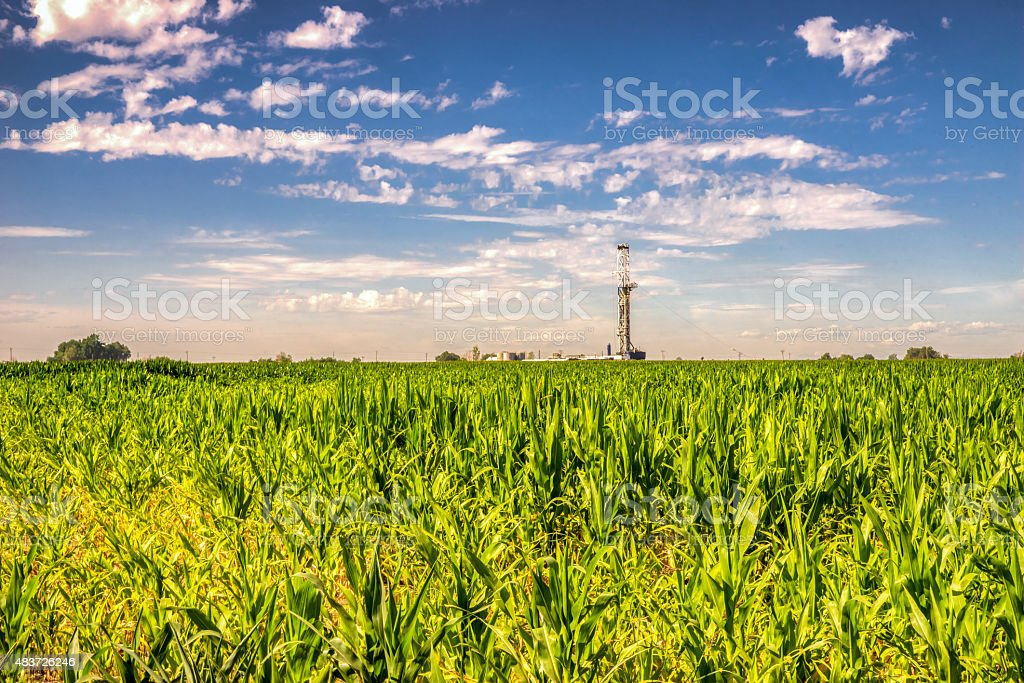Oil Drilling Fracking Rig on a Corn Field stock photo
