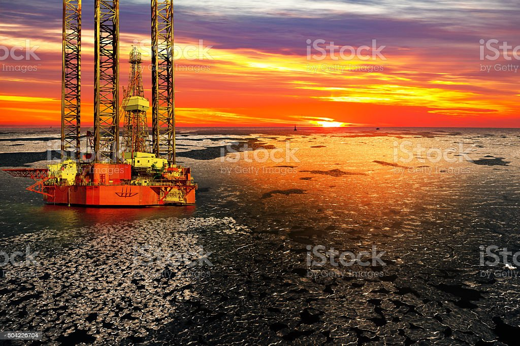 Oil drilling rig at sea in winter stock photo