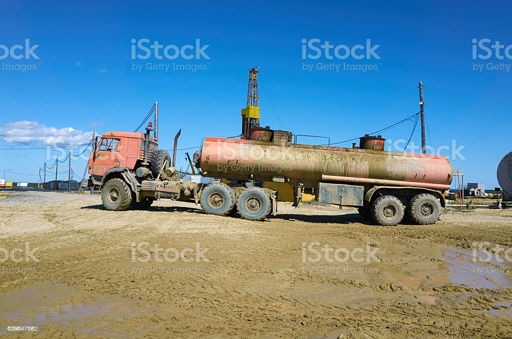 Oil drilling rig, gasoline tanker, technological area stock photo
