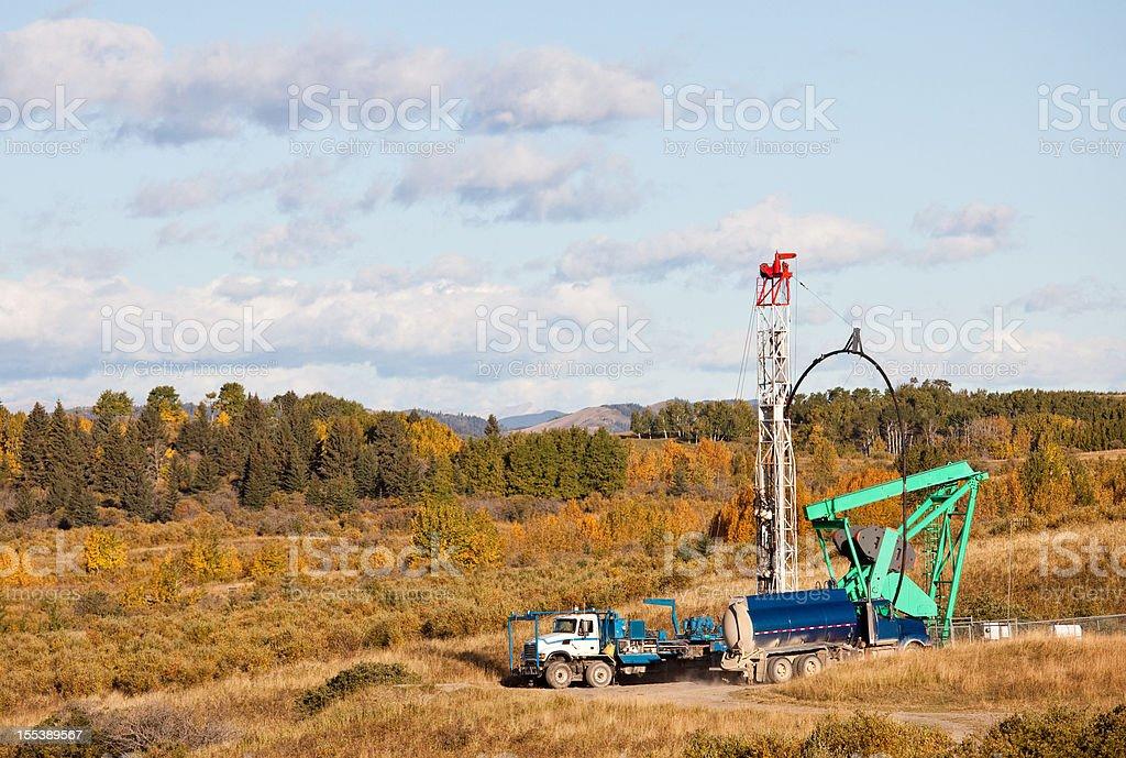 oil drilling rig in a field in Alberta's oil sands region stock photo