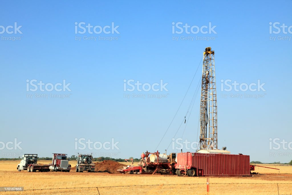 Oil Drilling Rig in a Field royalty-free stock photo