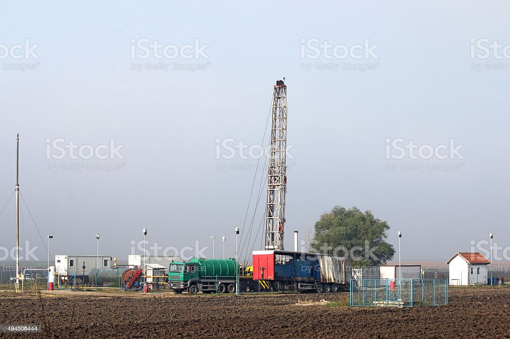 oil drilling rig on oilfield stock photo