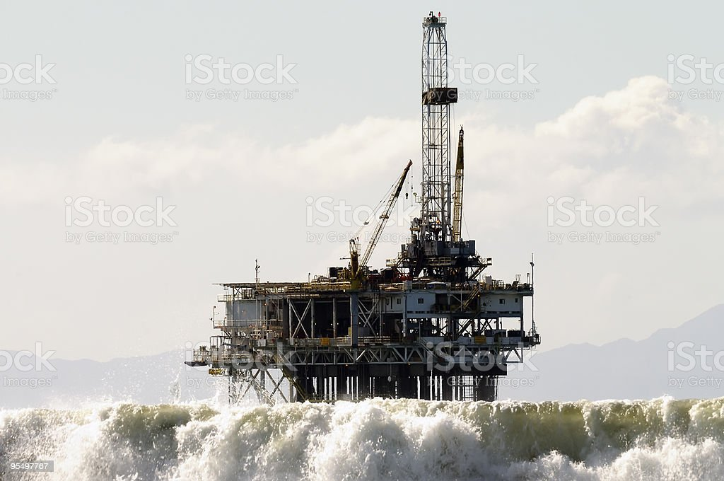Oil Drilling Rig on Top of Waterfall stock photo