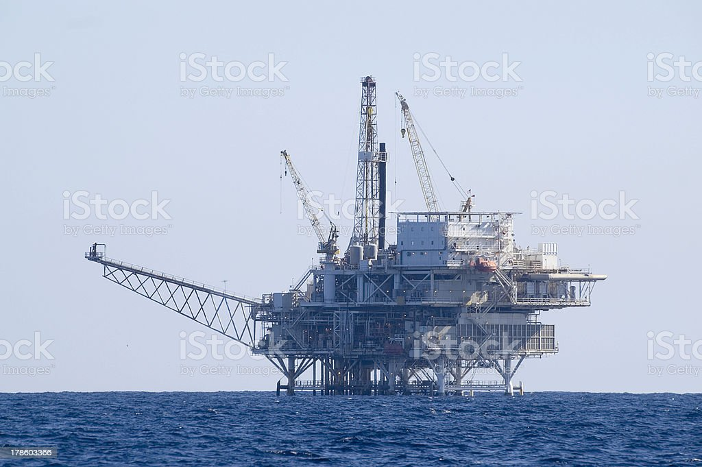 Oil drilling rig platform in the sea royalty-free stock photo