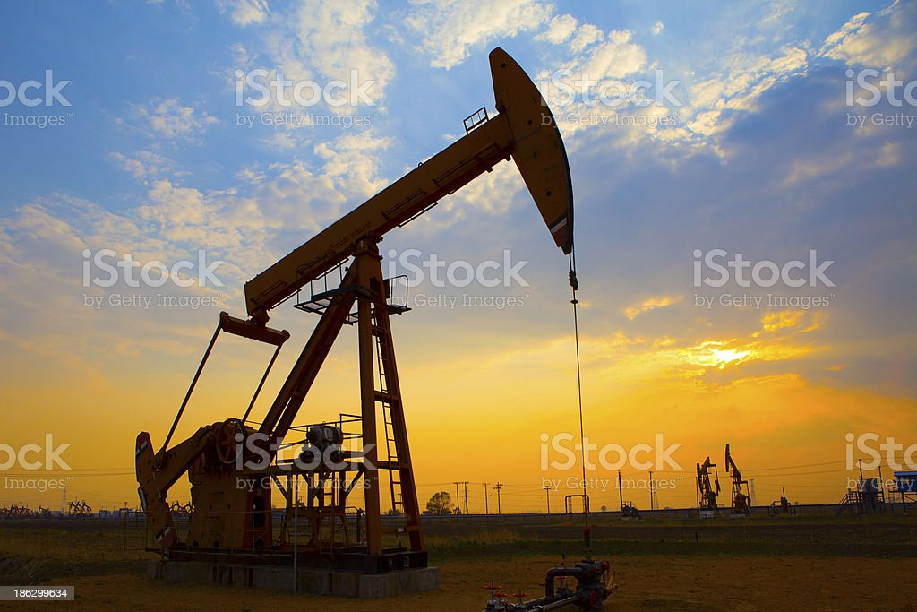 Oil drills pumping in the field stock photo
