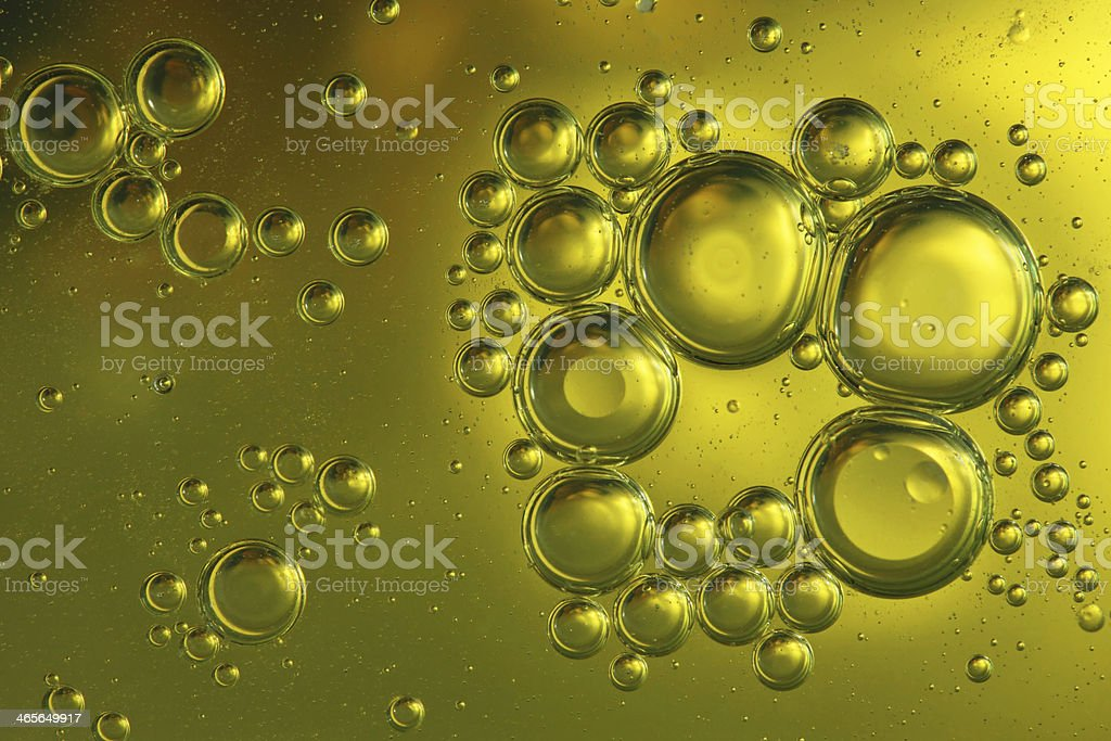 oil droplets in water stock photo