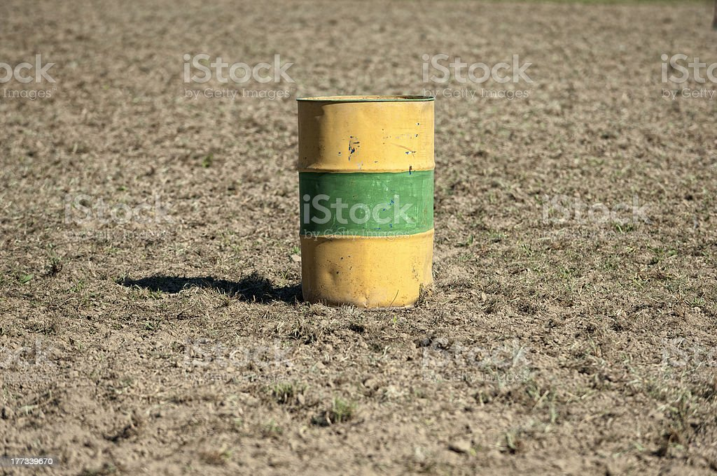 Oil drum in a field stock photo