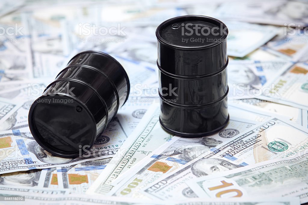 Oil drums on US dollars background stock photo