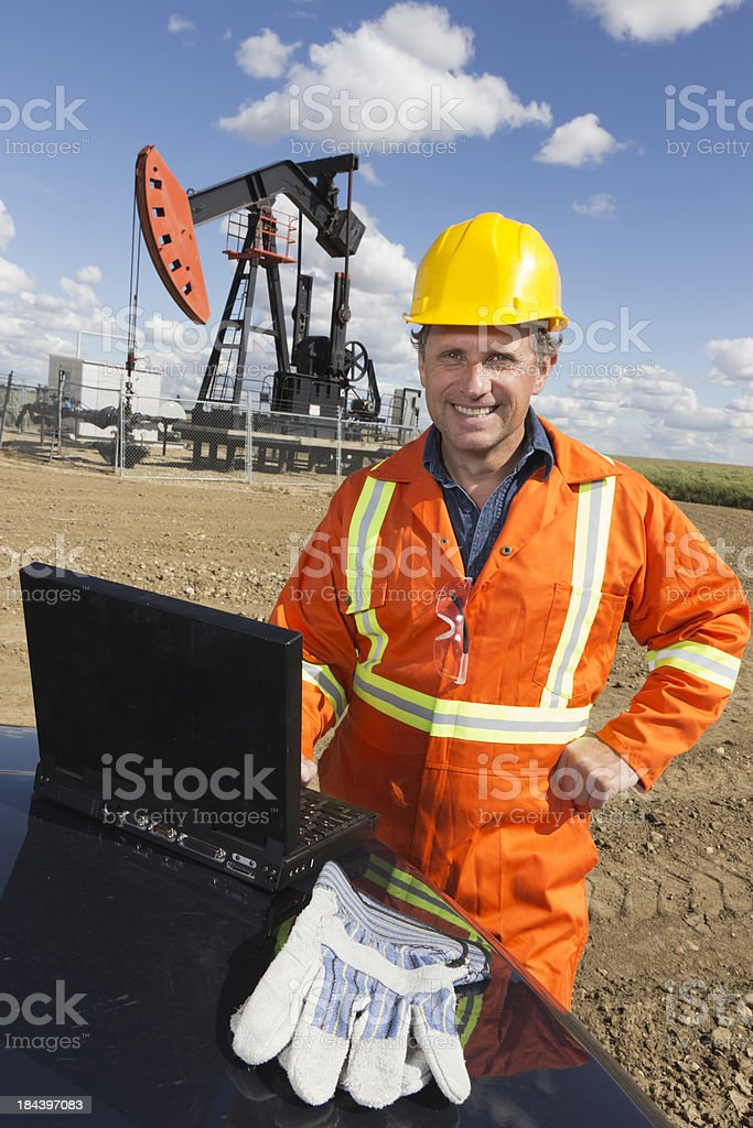 Oil Engineer and Laptop royalty-free stock photo