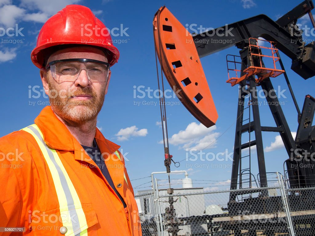 Oil Engineer and Pumpjack stock photo