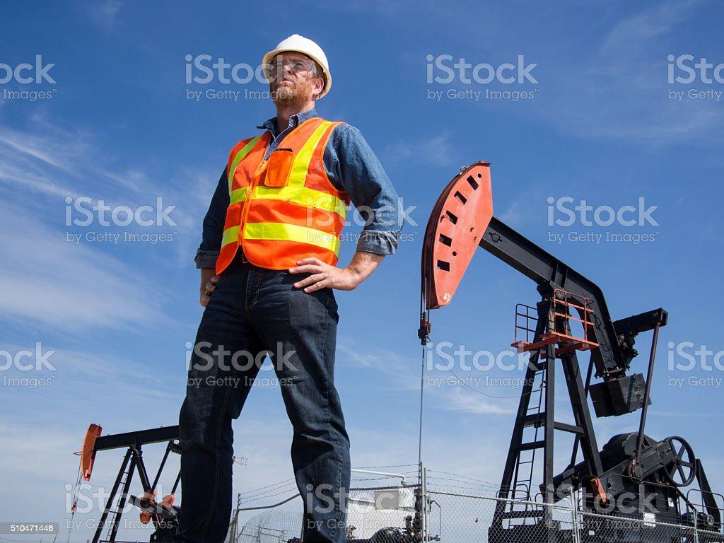 Oil Engineer and Pumpjkacks stock photo