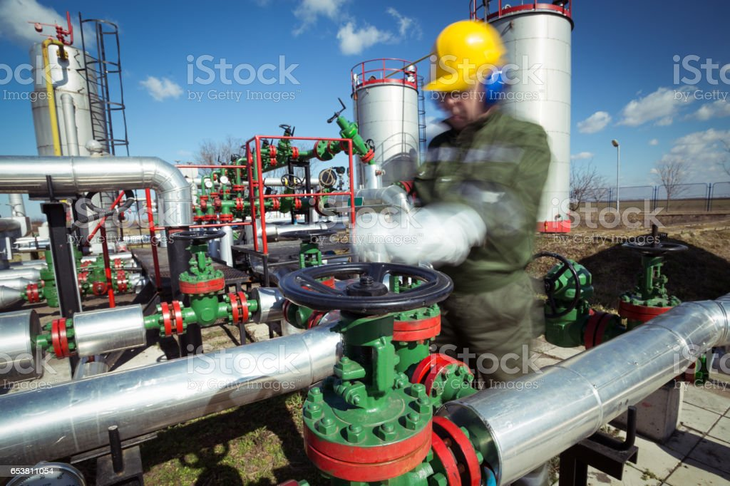 Oil engineer inside fuel industry stock photo