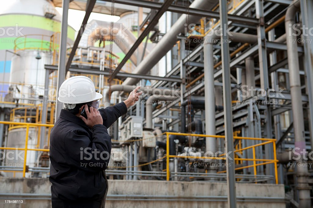 A oil engineer on the phone with a white hat on stock photo