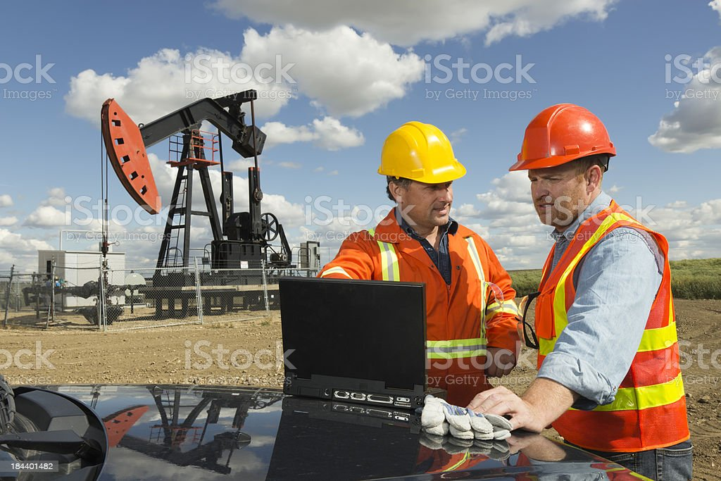 Oil Engineers and Computer stock photo